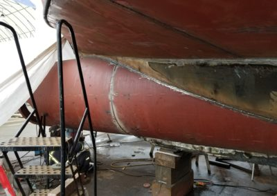 After proper fitting, the bulbous bow hull was welded to the vessel hull utilizing Lincoln 6011 root pass electrodes and Lincoln 7018 captain weld electrodes, with a Lincoln Welder.