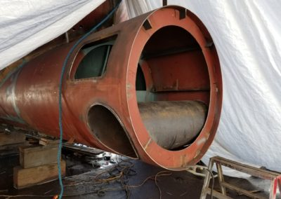 "The tube is installed for housing the 18"" diameter bow thruster, a Kobelt/Keypower hydraulic model. Above that is the access hatch."