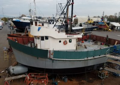 """Bulwark sheets and guard sections installed. Guard is 6"""" schedule 40 304 stainless steel pipe, cut in half to fit against the hull."""