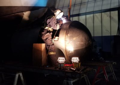 Welding the fairing plates into position.