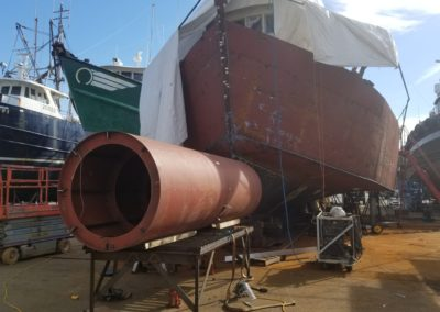 The full length of the bulbous bow's hull is positioned at the precise height for scribing the vessel's hull shape onto the bow hull.