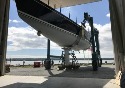 """With the keel blocked and clamped securely in place, the Travelift straps were used to gently """"rock"""" the hull from the keel after the nuts were removed from inside the hull."""