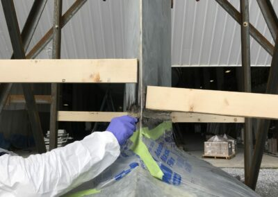 Excess epoxy is removed as it's squeezed out by the weight of the keel on the bulb.
